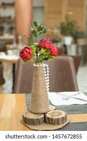 Romantic Valentine or other event celebration table setting with red paper roses and table setup in an East Mediterranean specific cuisine Lebanese Restaurant.