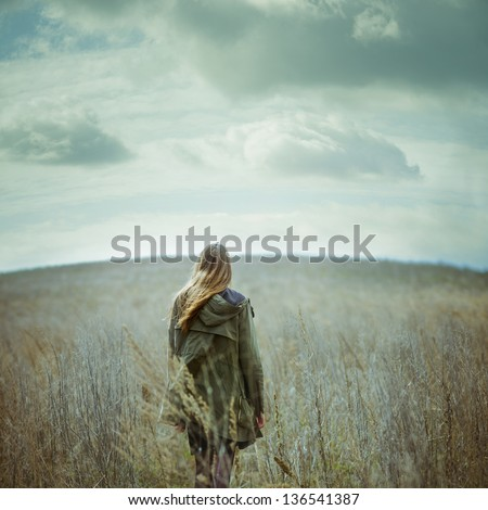 romantic vintage picture of beautiful girl in field