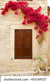 Romantic vintage scene, door and bougainvillea, Alacati, Cesme
