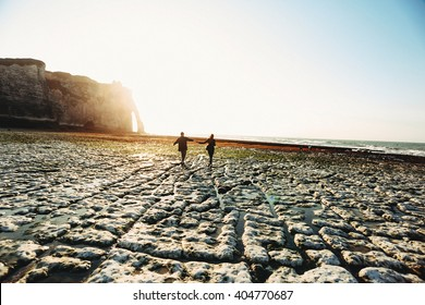 Romantic walk of a couple to the sea in France