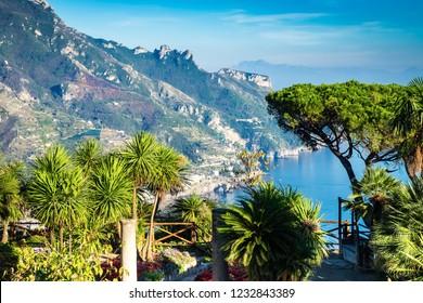 Romantic walkway and ornamental garden with colorful flowers, Villa Rufolo, Ravello, Amalfi coast, Italy