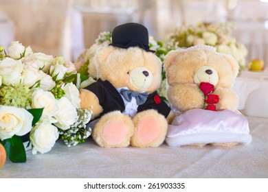 Romantic wedding in the banquet hall with teddy bears on the table.