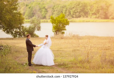 Romantic wedding couple having fun together outdoor in nature