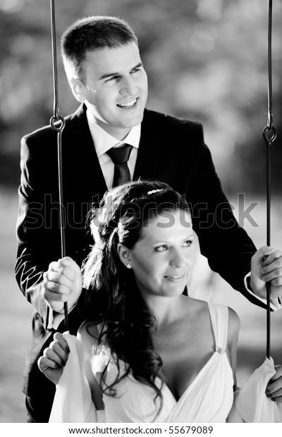 Husband and wife swinging