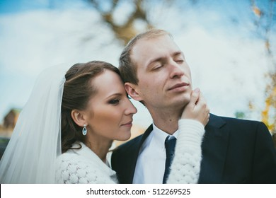 Romantic wedding couple is posing together in autumn