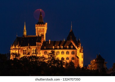 Romantic Wernigerode castle at night with the blood moon