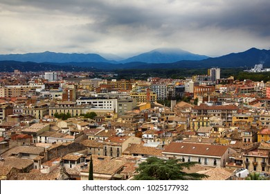 Romantic white city on hills - Spanish town Girona in foothills of Pyrenees - between peaks of Pyrenees mountains and Mediterranean sea. Border of old and new city