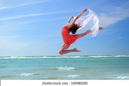Romantic woman jumping on the beach