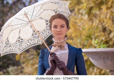 Romantic young beautiful lady outdoors. Victorian style