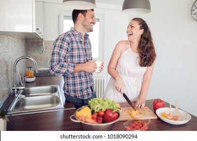 Romantic young couple cooking together in the kitchen.Young couple cutting vegetables  in the kitchen.