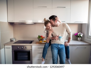 Romantic young couple cooking together in the kitchen,having a great time together.