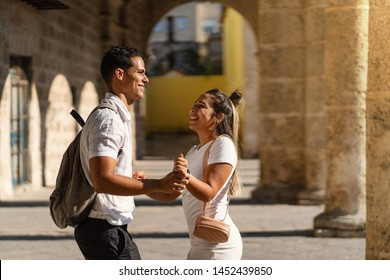 Romantic young couple dancing together in the street. Lifestyle. Havana, Cuba.