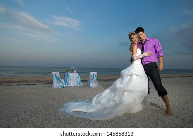Romantic young couple kissing on the beach