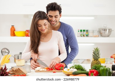 Romantic young couple preparing dinner.