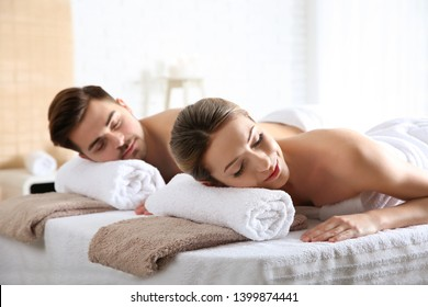 Romantic young couple relaxing in spa salon