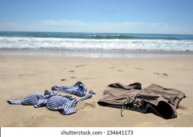 Romantic young couple skinny dipping in the sea. Travel holiday vacation concept. No people. Copy space