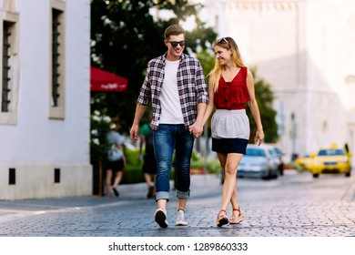 Romantic Young Couple Walking in the City. Relationship concept.
