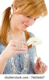 Romantic young happy woman hold gerbera daisy piece symbol on white
