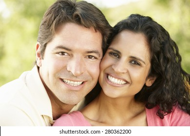 Romantic Young Hispanic Couple Relaxing In Park