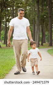 Romantic Young Indian-Caucasian Mixed Race Family with Young Son in White and Khaki Outdoors in Autumn