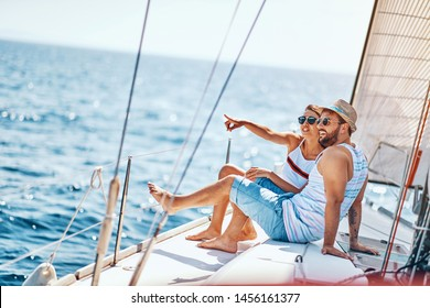 Romantic young man and woman spending time together and relaxing on yacht