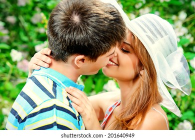 Romantic young people tenderly kissing outdoor. Love concept.