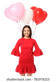 Romantic young woman with heart-shaped balloons for Valentine's Day on white background