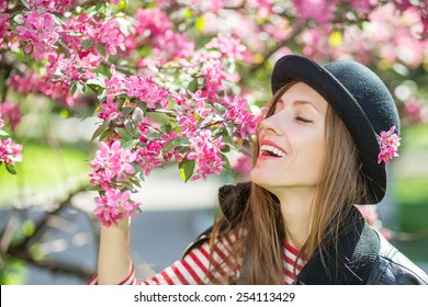 Romantic young woman in spring garden