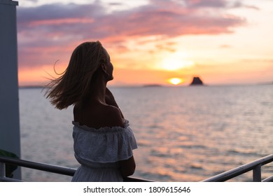 Romatic portrait of woman in dress stand on ferry at sunset with amazing sea view