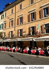 Rome 20 November 2015. Caffe Barocco. Piazza Navona. Tables with red tablecloths lined up. Sunny.