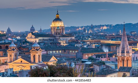Rome Aerial View of skyline cityscape rooftop panorama, San Carlo al Corso Church at night, Vittorio Emanuele, Piazza Venezia with St Peter Cathedral (Prominent Basilica San Pietro in Vatican), Italy
