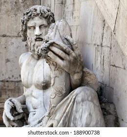 ROME - APRIL 06: Roman representation of Tiber as a god (Tiberinus) with cornucopia at the Campidoglio, on April 06, 2014 in Rome, Italy.