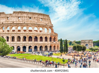 ROME - APRIL 2, 2016 - Tourists walking by the Colosseum in Rome, April 2, 2016. The Colosseum is an iconic symbol of Imperial Rome. In 2007 the complex was included among the New7Wonders of the World