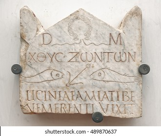Rome - August 14, 2016: Funerary stele of Lucinia Amias, one of the most ancient Christian inscriptions in Rome.It is characterized by the pagan consecration to the Gods Manes wit Christian symbolism