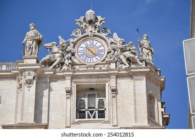 ROME - AUGUST 27, 2014: Sculptures and clock on the facade of Vatican city works, Vatican, Rome, Italy