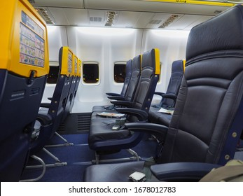 Rome Ciampino Airport, Italy - 10 02 2018: Empty Airplane Boeing 737 at the Ciampino airport in Rome, Italy. Aircraft interior of Ryanair Airlines without people, without tourists, only blue seats.