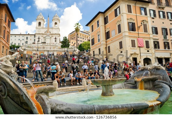 ROME - CIRCA OCTOBER 2012: The Spanish Steps, seen from Piazza di Spagna with the Fountain Barcaccia in Rome. Spanish Steps are the widest staircase in Europe. Tourists visit Spanish Steps in summer.