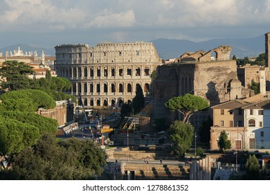 Rome cityscape with the famous ancient Roman wonder Coliseum, Colosseum or Colosseo, and the Imperial Fora (Fori Imperiali in Italian), a series of monumental fora (public squares)