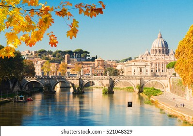Rome cityscape, St. Peter's cathedral over bridge and river water at fall day in Rome, Italy