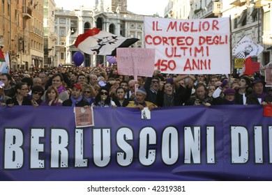 "ROME – DEC. 5 : Crowd hold protest at ""No Berlusconi Day"" December 5, 2009 in Rome. Italian Premier Silvio Berlusconi under pressure to resign due to his sex scandal and corruption charges."