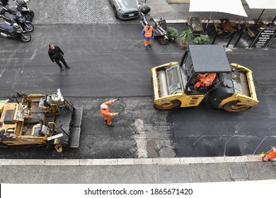 ROME DICEMBER 01 2020 MEN AT WORK TO REDO THE ASPHALT OF A ROAD