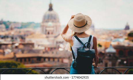 Rome Europe Italia travel summer tourism holiday vacation background -young smiling girl with mobile phone camera and map in hand standing on the hill looking on the cathedral Vatican - Shutterstock ID 1774042925