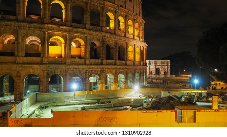 Rome / Italy - 02 09 2019: The Eternal Italian city with his famous places Amphitheater Colosseum and Arch of Constantine at night. Construction of a new metro line C in the historical center of Rome.