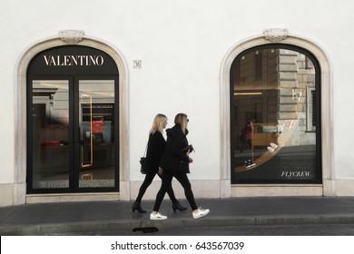 Rome, ITALY - 02 May 2017: Pedestrian look at Valentino shop window at Via Condotti, Rome Italy.