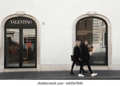 Rome, ITALY - 02 May 2017: Pedestrian look at Valentino shop window at Piazza di Spagna, Rome Italy.