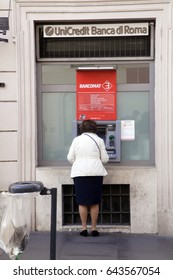 Rome, ITALY - 02 May 2017: Woman at the cash machine at downtown inRome, Italy.