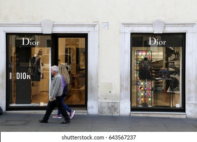 Rome, ITALY - 02 May 2017: Pedestrians walk past of Dior store at downtown of Rome Italy