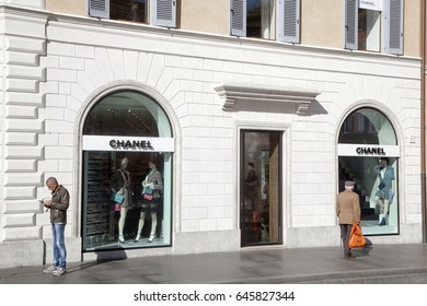 Rome, ITALY - 02 May 2017: Pedestrian look at shop window of Chanel store at Piazza Di Spagna in Rome Italy
