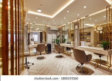Rome, Italy, 02.02.2020, Interior of luxury beauty salon in golden color