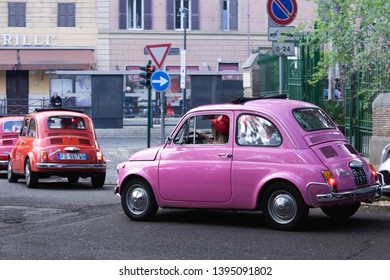 Rome, Italy/ 04/14/2019 vintage italian colorful cars fiat 500 are on the city street. rally of vintage economy car Fiat